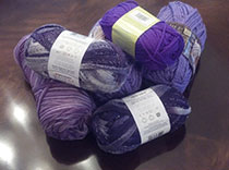 Tons of purple wool to keep our knitters working for epilepsy